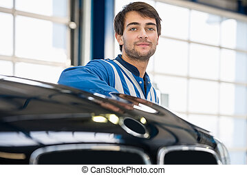 Mechanic Discussing With Female Customer In Garage