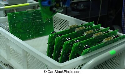 A worker sorts printed circuit boards FullHD