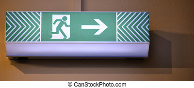 Emergency exit sign - Lit emergency exit sign mounted to the...