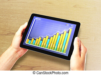 Man hands with digital tablet with business chart on desktop