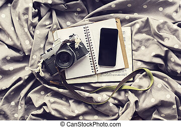 Blank smartphone screen with diary, old style photo camera...