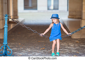 Adorable fashion little girl outdoors in European city -...