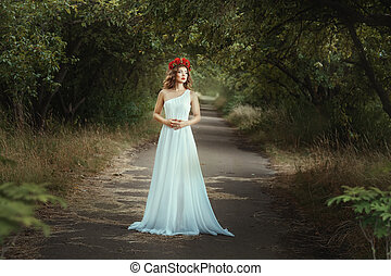 Fairy girl standing on the road in woods - Fairy girl...