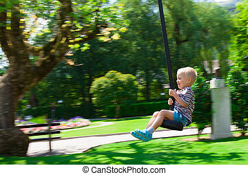 Horse rope - The little boy enjoying a ride in a rope park...