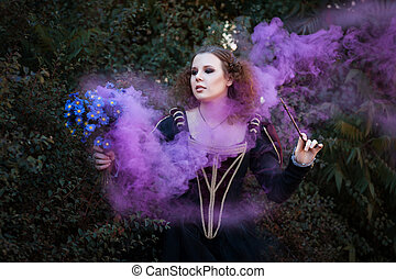 Woman showing tricks with a magic wand She bewitched a...