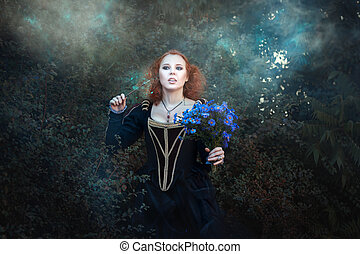 Sweet red-haired fairy in the woods In her hand she had a...