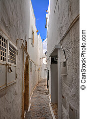 Narrow street of ancient Medina, Hammamet, Tunisia,...