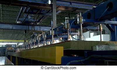 Machine moving chipboard from conveyor in heap