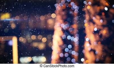 defocused christmas lights in wintry city