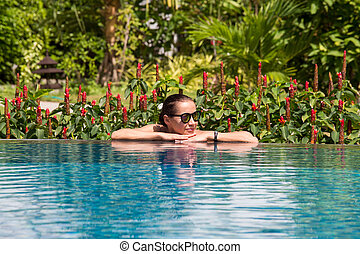 Young woman in the swimming pool - Beautiful happy woman...