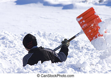 Shoveling Snow - Young Boy shoveling the snow
