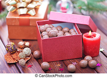 chocolate candy in box and on a table