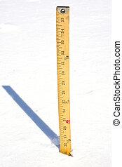 Measuring Snow - Yardstick measuring snow after storm