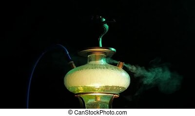 One colored yellow hookah with the smoke, close up slow...