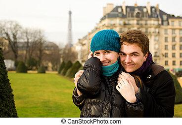 Happy loving couple in Paris, hugging