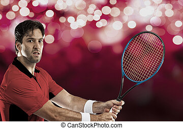 Tennis Player - Tennis player with a red shirt, playing on...