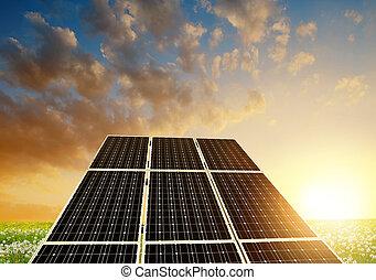 Solar energy panels against sunset skyClean energy
