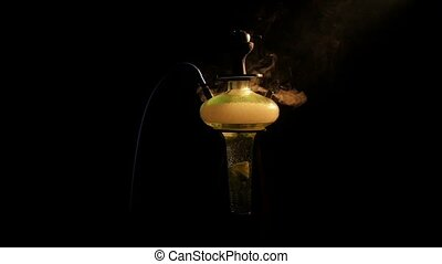 Usual yellow shisha on lounge caffee. slow motion - Colored...