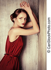 evening dress - Sensual young lady in red dress posing an...