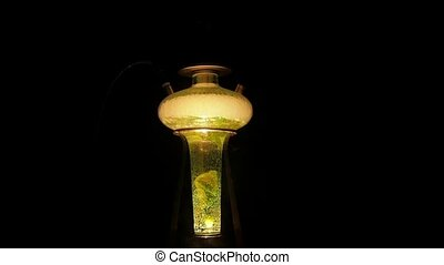 Light yellow hookah on lounge caffee. slow motion - Colored...