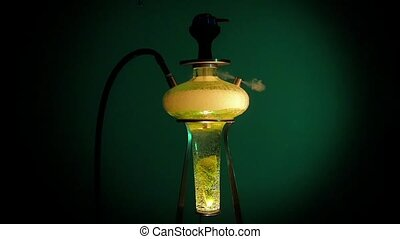 One yellow hookah on lounge caffee. slow motion - Colored...