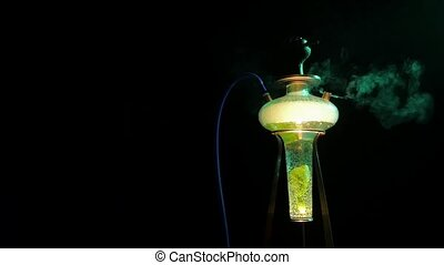 Colored yellow hookah with the smoke, close up. slow motion