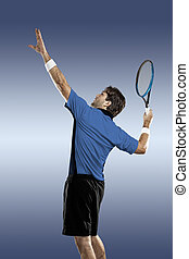 Tennis Player. - Tennis player with a blue shirt, playing on...