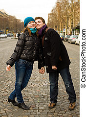 Happy romantic couple in Paris on the Champs Elysees