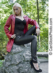 blond girl with red coat
