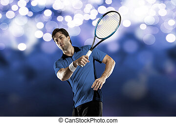 Tennis Player - Tennis player with a blue shirt, playing on...