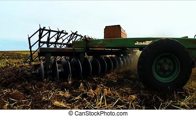 Rural Tractor With Trailer Moving In Field