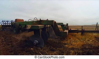 Tractor Trailer Plowing Agricultural Field - SLOW MOTION:...