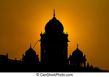Silhouette Temple in Amritsar, India at sunset - Silhouette...