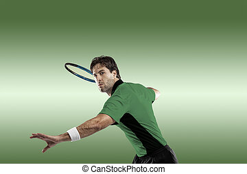 Tennis Player - Tennis player with a green shirt, playing on...