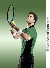 Tennis Player. - Tennis player with a green shirt, playing...