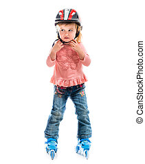 little preschool girl on rollerskates isolated on white...