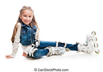 cute teenager girl on rollerskates sitting on the floor...