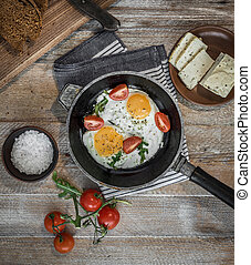 fried eggs in a frying pan top view - fried eggs in a frying...