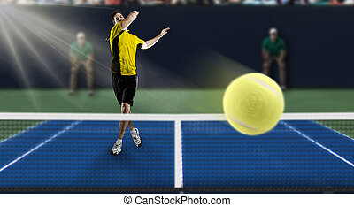Tennis Player. - Tennis player with a yellow shirt, playing...