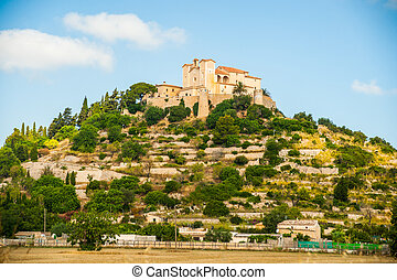 Pilgrimage church of Sant Salvador on green hill in Arta...