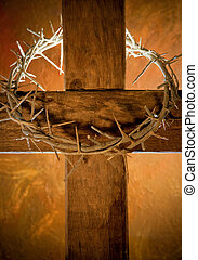 Easter cross - Crown of thorns hanging on a wooden cross at...