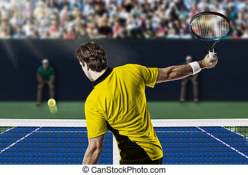 Tennis Player. - Tennis player with a yellow shirt,...