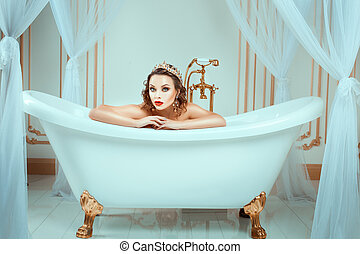 Nude woman sitting in expensive jewelry bath Crown on his...