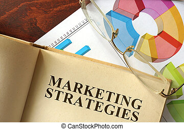 Marketing strategies - Book with marketing strategies on a...