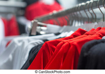 red shirt hanging on a hanger in the store