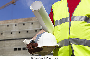 under construction - builder with white hardhat and...