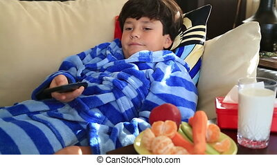 Child watching tv - 9 years old child watching tv lying on...