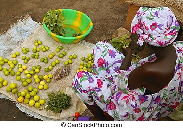 African market lemon limes and woman - African market bird...