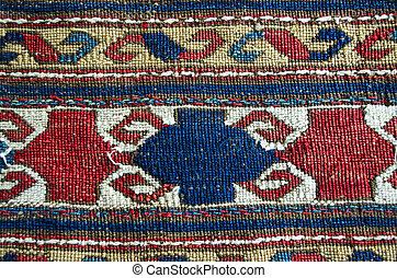 Detail old napless woolen carpet - Detail of pattern on the...