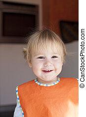 happy baby face orange bib looking